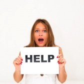 10888655-need-help-portrait-young-woman-with-board-help