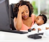 22138803-frustrated-african-american-businesswoman-with-her-little-baby-in-office