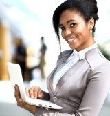 27545513-business-woman-standing-in-foreground-with-laptop-in-her-hands-her-co-workers-discussing-business-ma (1)